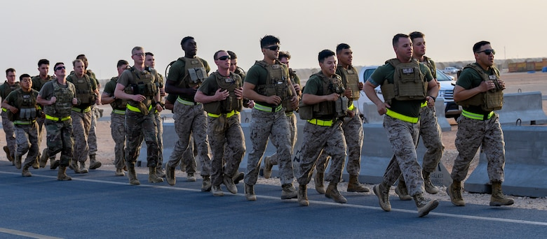 Air Force and Marine Corps personnel run during morning physical training.