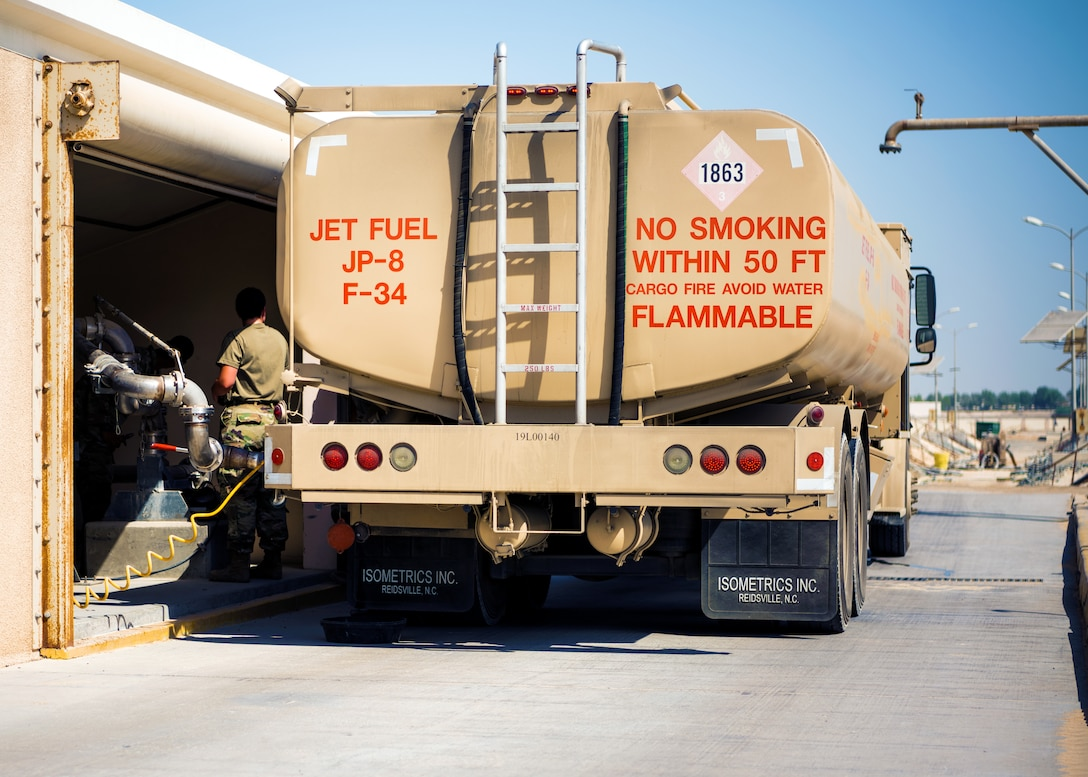 U.S. Air Force Airmen from the 380th Expeditionary Civil Engineer Squadron water & fuel systems maintenance and the 380th Expeditionary Logistic Readiness Squadron fuels flight perform maintenance on a fuels system at Al Dhafra Air Base, United Arab Emirates, June 14, 2021.