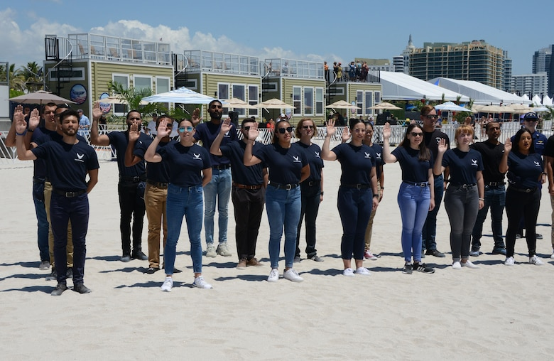 Air Force Delayed Entry Program members performed their oath of enlistment on Miami Beach as part of a mass joint enlistment during the Miami Beach Air Show, May 28, 2021.