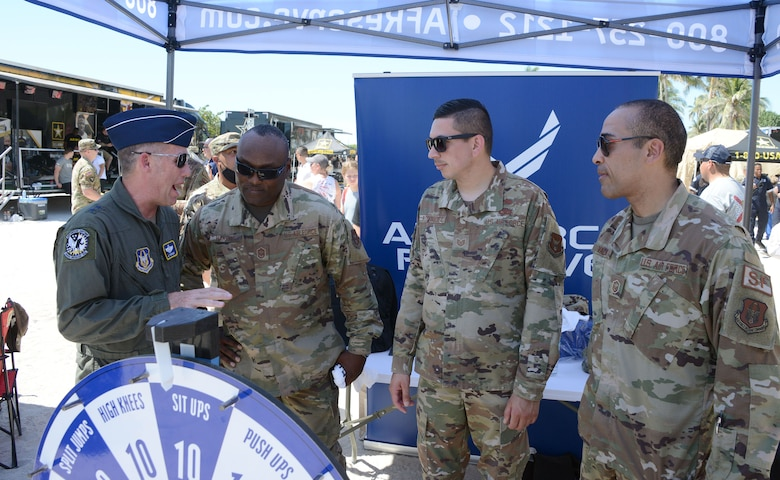 Maj. Gen. Matthew Burger, Air Force Reserve Command deputy commander, talks to a group of Reserve recruiters from Homestead Air Reserve Base, Florida, during  the Miami Beach Air Show, May 28, 2021
