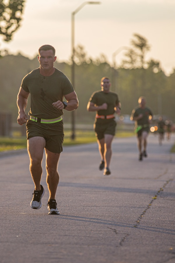 U.S. Marines with 2d Marine Division (MARDIV) run during a physical fitness test as part of the Division Leadership Assessment Program (DLAP) on Camp Lejeune, N.C., June 15, 2021.