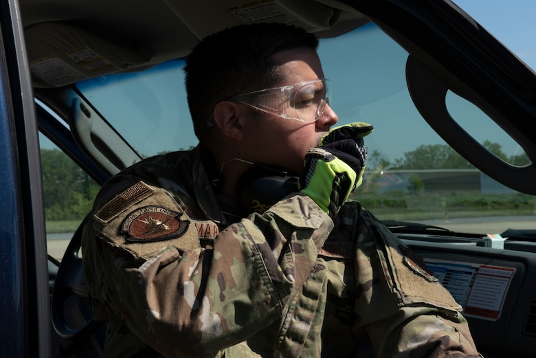 U.S. Air Force Master Sgt. Jose Marrero, noncommissioned officer in charge of airfield management with the 167th Operations Support Group, notifies air traffic control before firing pyrotechnics as part of the Bird/wildlife Aircraft Strike Hazards (BASH) program, at the 167th Airlift Wing, Martinsburg, West Virginia, May 12, 2021. The airfield management team uses many different types of noise making devices to encourage animals to move away from the airfield to ensure safe flying operations.