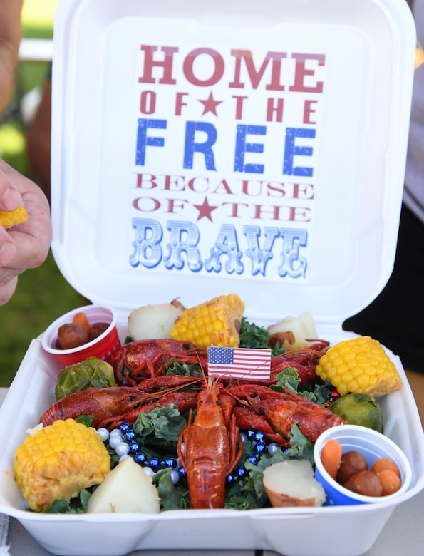 """A presentation platter created for the judges by the Second Air Force team, """"Krewe of Kraw,"""" is on display during the 9th Annual Crawfish Cook-Off at the Bay Breeze Event Center at Keesler Air Force Base, Mississippi, June 11, 2021. Twelve teams competed in the event and more than 800 pounds of crawfish were distributed. (U.S. Air Force photo by Kemberly Groue)"""