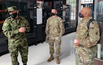 Col. Jeffrey Lopez (right), U.S. Army South Security Cooperation Directorate chief, and Col. Chip Karels (center), U.S. Army South G7 Training and Exercises director, tour the Colombian Army Infantry Museum with the Colombian Army Infantry School Commandant Col. Suarez Giraldo Cesar Augusto (left) June 10, in Bogotá, during the 12th Annual U.S., Colombian Army-to-Army Staff Talks.
