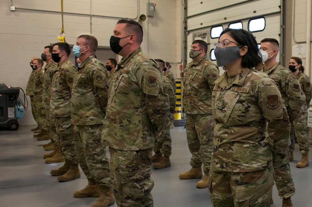 Members of the Connecticut Air National Guard, 103rd Air Control Squadron stand in formation during a briefing by Maj. Gen. Fran Evon, The Adjutant General of the Connecticut National Guard, April 15, 2021 in Orange, Connecticut. Members of 103rd ACS deployed to multiple locations in Southwest Asia and the United States in support of Operation Inherent Resolve and Mission Resolute Support. (U.S. Air National Guard photo by Master Sgt. Tamara R. Dabney)