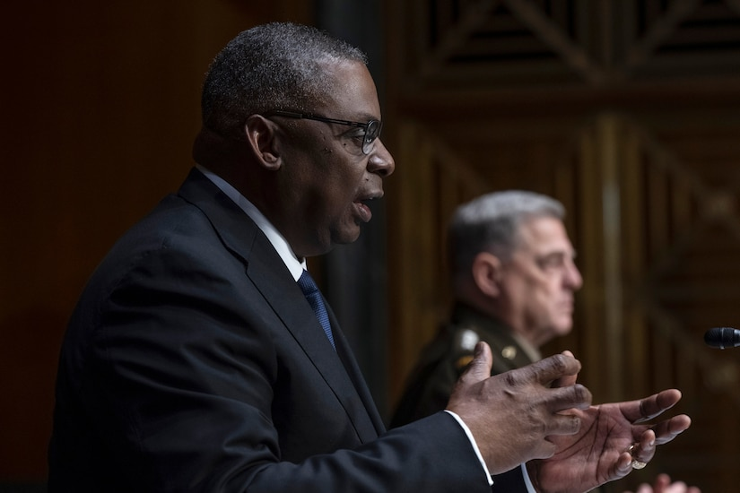 Secretary Austin gestures while speaking to the Senate committee.