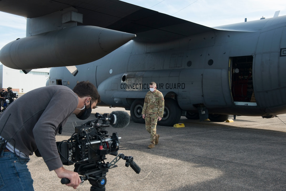 Tech. Sgt. Leon Bardwell, III, a loadmaster assigned to the 103rd Airlift Wing, participates in a video shoot for a commercial to promote the Air National Guard, April 7, 2021 at Bradley Air National Guard Base, Connecticut. The commercial, part of the 'Serve Your Way' campaign, highlights how and why Air National Guard members serve in the Guard. (U.S. Air National Guard photo by Master Sgt. Tamara R. Dabney)
