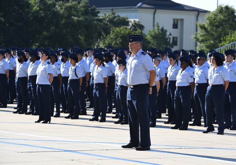 U.S. Air Force Col. James Kafer, 81st Training Wing vice commander, stands in formation with Airmen from the 81st Training Group during the 81st TRW change of command ceremony on the Levitow Training Support Facility drill pad at Keesler Air Force Base, Mississippi, June 17, 2021. The ceremony is a symbol of command being exchanged from one commander to the next by the handing-off of a ceremonial guidon. Col. Heather Blackwell relinquished command of the 81st TRW to Col. William Hunter. (U.S. Air Force photo by Kemberly Groue)