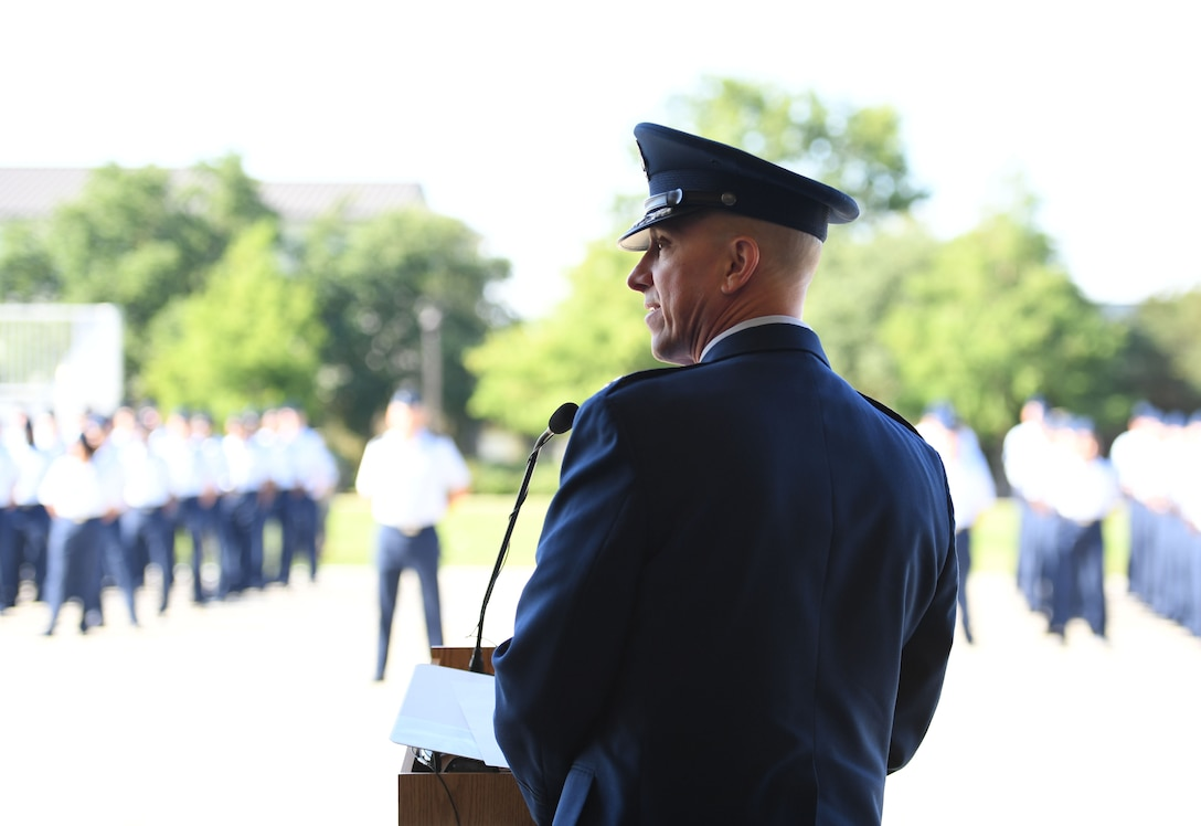 U.S. Air Force Col. William Hunter, 81st Training Wing commander, addresses his new command during a change of command ceremony on the Levitow Training Support Facility drill pad at Keesler Air Force Base, Mississippi, June 17, 2021. Hunter assumed command of the 81st TRW from Col. Heather Blackwell. (U.S. Air Force photo by Kemberly Groue)