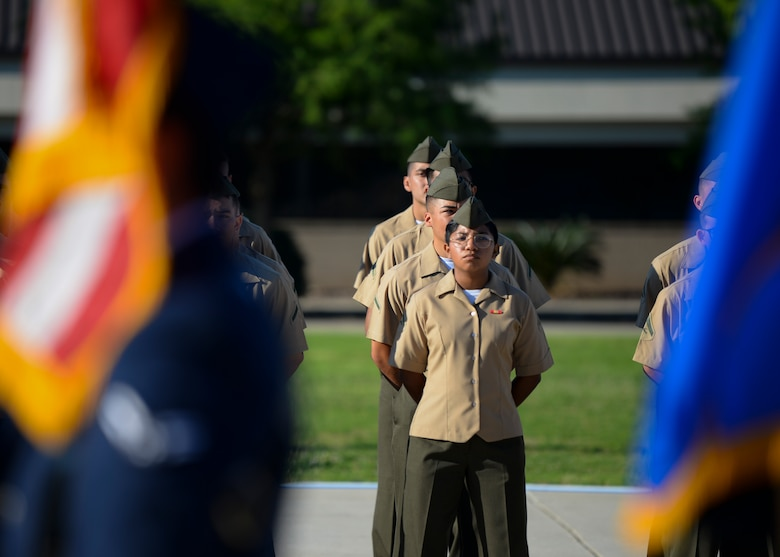 Marines from the 81st Training Group stand in formation during the 81st Training Wing change of command ceremony on the Levitow Training Support Facility drill pad at Keesler Air Force Base, Mississippi, June 17, 2021. The ceremony is a symbol of command being exchanged from one commander to the next by the handing-off of a ceremonial guidon. U.S. Air Force Col. Heather Blackwell relinquished command of the 81st TRW to Col. William Hunter. (U.S. Air Force photo by Senior Airman Spencer Tobler)