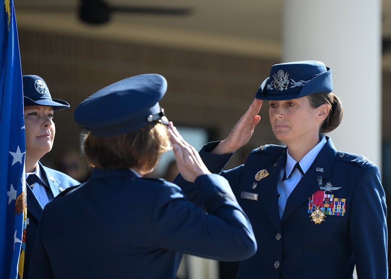 U.S. Air Force Col. Heather Blackwell, outgoing 81st Training Wing commander, salutes Maj. Gen. Andrea Tullos, Second Air Force commander, during the change of command ceremony on the Levitow Training Support Facility drill pad at Keesler Air Force Base, Mississippi, June 17, 2021. The ceremony is a symbol of command being exchanged from one commander to the next by the handing-off of a ceremonial guidon. Blackwell is now assigned to the Air Combat Command. (U.S. Air Force photo by Senior Airman Spencer Tobler)