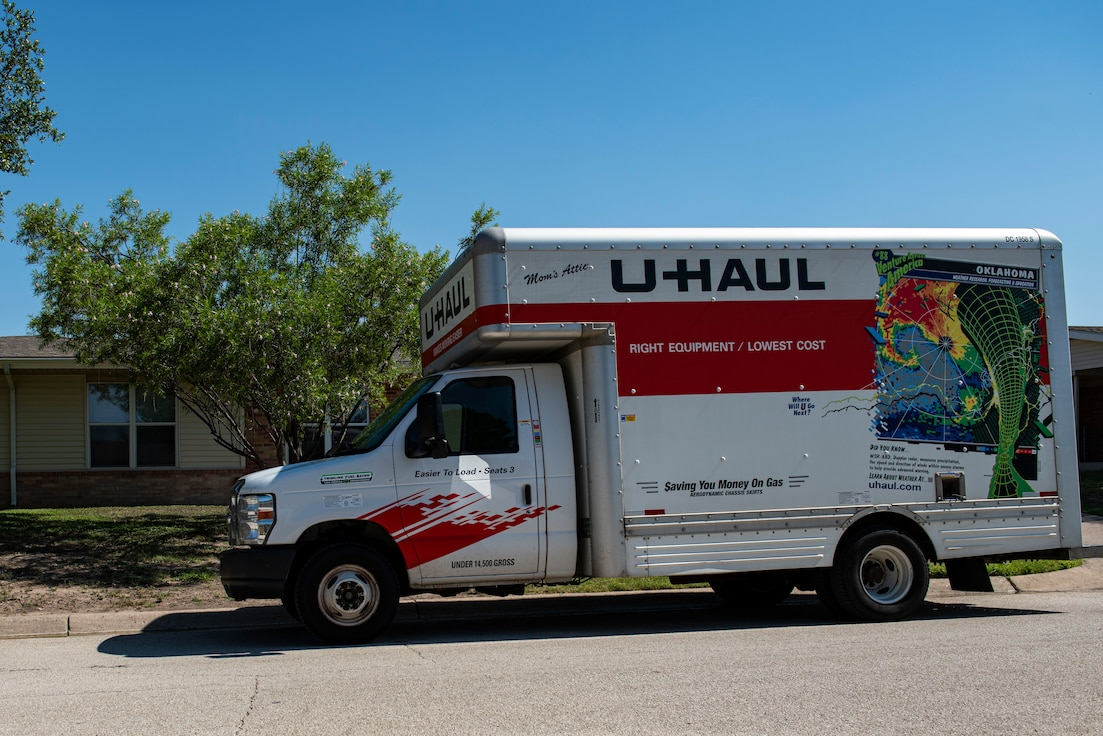 A moving truck sits at the ready to move a family from Laughlin Air Force Base, Texas, June, 16, 2021 to their new home and