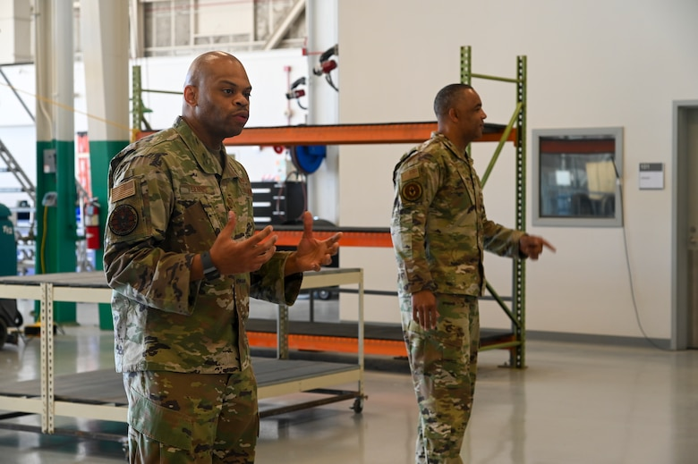 Chief Master Sgt. Timothy C. White Jr., command chief master sergeant, and Chief Master Sgt. Travon W. Dennis, command first sergeant, both from Air Force Reserve Command, Robins Air Force Base, Georgia, speak with 940th Air Refueling Wing maintainers June 12, 2021, at Beale AFB, California.