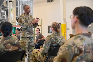 Chief Master Sgt. Timothy C. White Jr., command chief master sergeant, Air Force Reserve Command, Robins Air Force Base, Georgia, speaks with Airmen at an E-4 and Below meeting June 13, 2021, at Beale AFB, California.
