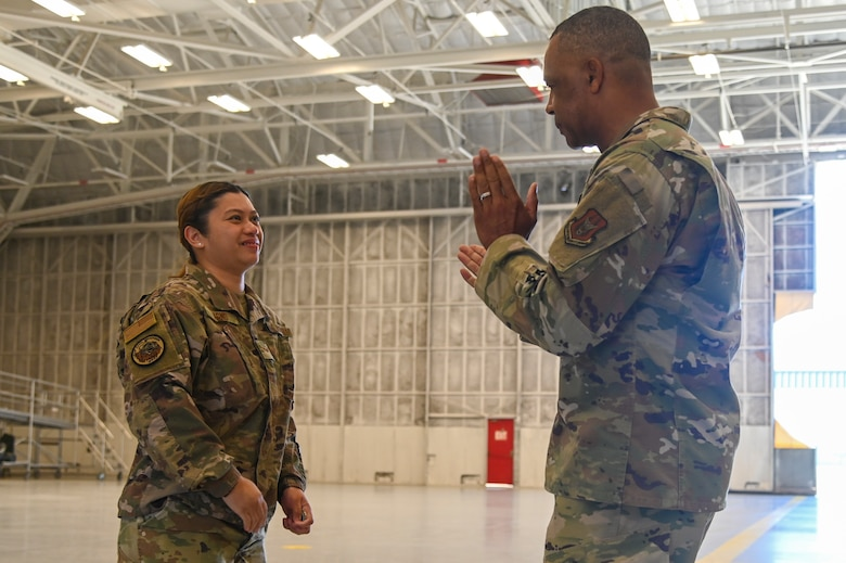 Chief Master Sgt. Timothy C. White Jr., command chief master sergeant, Air Force Reserve Command, Robins Air Force Base, Georgia, applauds Senior Airman Anna Agno from the 940th Civil Engineer Squadron, Beale AFB, during an E-4 and Below meeting June 13, 2021, at Beale AFB, California.