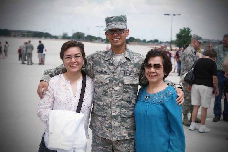 Staff Sgt. Kenichi Watanabe with his expecting wife at Shaw Air Force Base in 2021.