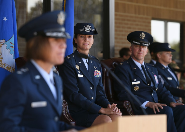 U.S. Air Force Col. Heather Blackwell, outgoing 81st Training Wing commander, and Col. William Hunter, incoming 81st TRW commander, looks on as Maj. Gen. Andrea Tullos, Second Air Force commander, delivers remarks during the change of command ceremony on the Levitow Training Support Facility drill pad at Keesler Air Force Base, Mississippi, June 17, 2021. The ceremony is a symbol of command being exchanged from one commander to the next by the handing-off of a ceremonial guidon. Blackwell is now assigned to the Air Combat Command. (U.S. Air Force photo by Kemberly Groue)