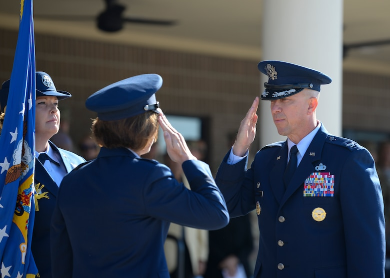 U.S. Air Force Col. William Hunter, 81st Training Wing commander, salutes Maj. Gen. Andrea Tullos, Second Air Force commander, during the change of command ceremony on the Levitow Training Support Facility drill pad at Keesler Air Force Base, Mississippi, June 17, 2021. The ceremony is a symbol of command being exchanged from one commander to the next by the handing-off of a ceremonial guidon. Hunter assumed command of the 81st TRW from Col. Heather Blackwell. (U.S. Air Force photo by Senior Airman Spencer Tobler)