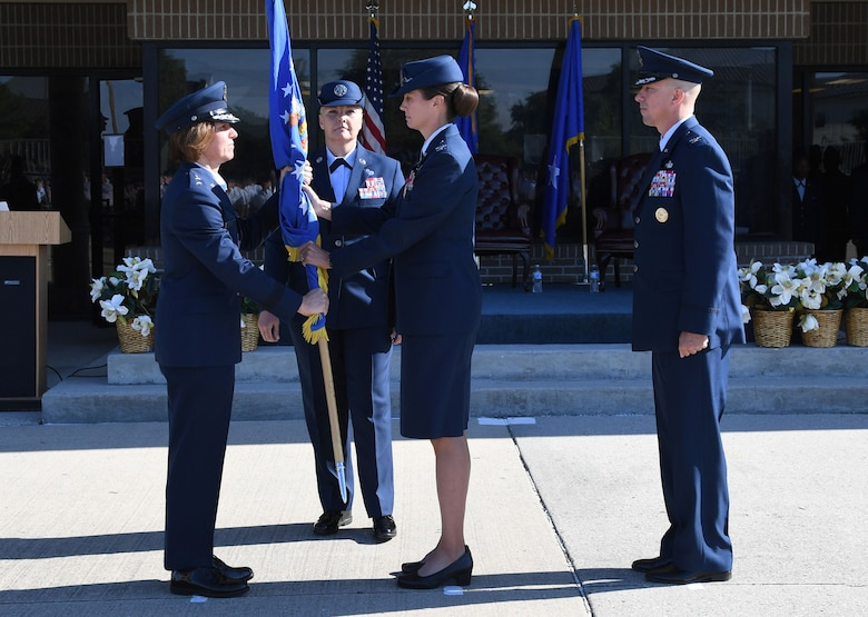 U.S. Air Force Maj. Gen. Andrea Tullos, Second Air Force commander, takes the guidon from Col. Heather Blackwell, outgoing 81st Training Wing commander, during the change of command ceremony on the Levitow Training Support Facility drill pad at Keesler Air Force Base, Mississippi, June 17, 2021. Blackwell is now assigned to the Air Combat Command. (U.S. Air Force photo by Kemberly Groue)