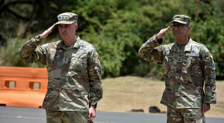 Two military people saluting