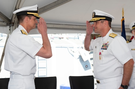 Rear Adm. Craig Clapperton, Commander, Carrier Strike Group (CSG) 12, requests to be relieved by Rear Adm. Gregory Huffman during the CSG-12