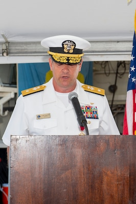 Rear Adm. Craig Clapperton, Commander, Carrier Strike Group (CSG) 12, reads his orders during the CSG-12 Change of Command ceremony aboard the guided-missile destroyer USS Bulkeley (DDG 84) June 17.
