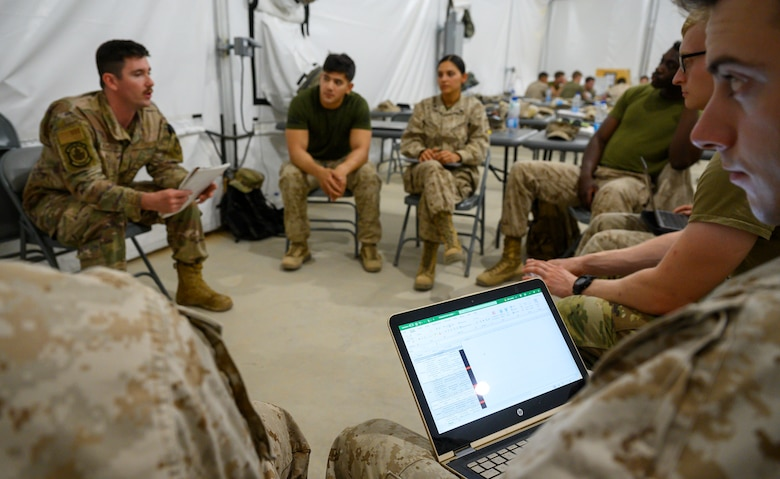 Airman giving presentation to his group.