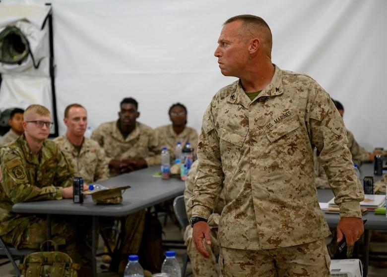 Marine Corps unit commander briefs class.