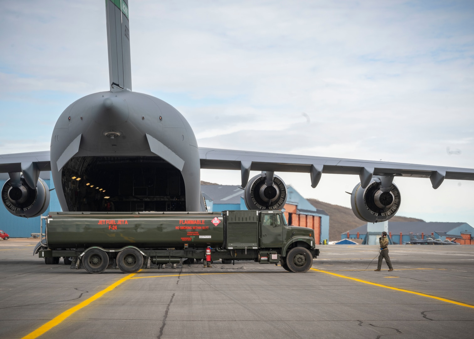 U.S. Air Force Airmen assigned to the 140th Wing and 4th Airlift Squadron preform a wet-wing defuel during exercise Amalgam Dart 21-01, June 16, 2021 at Thule Air Base, Greenland.