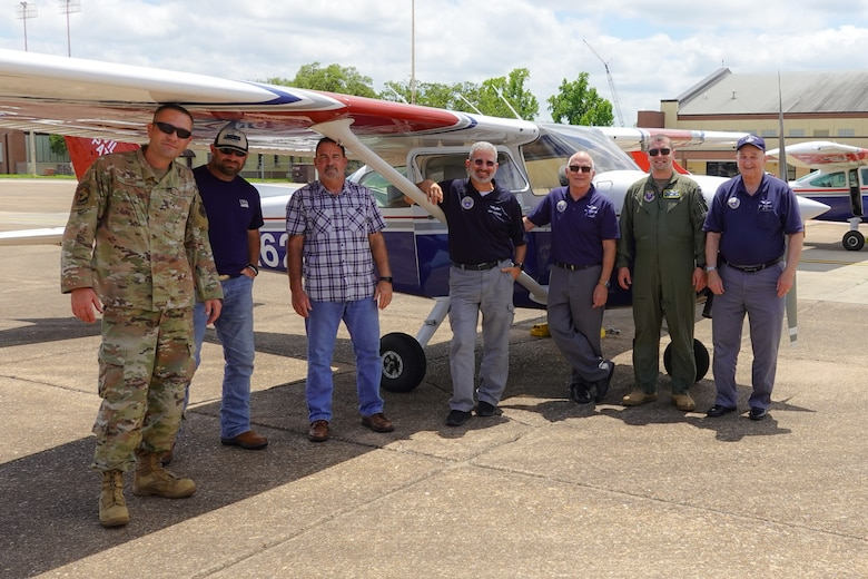 Airmen from the 2nd Bomb Wing flight safety office and members from the Shreveport Civil Air Patrol, pose for a photo at Barksdale Air Force Base during a Mid-Air Collision Avoidance safety training May 28, 2021. MACA is a program where members of the flight safety office travel to various airports spreading general awareness of hazards in the area, educating local aviators by answering their questions and avoiding mid-air collisions through preparedness. (Courtesy photo by Capt. Dustin Martin)