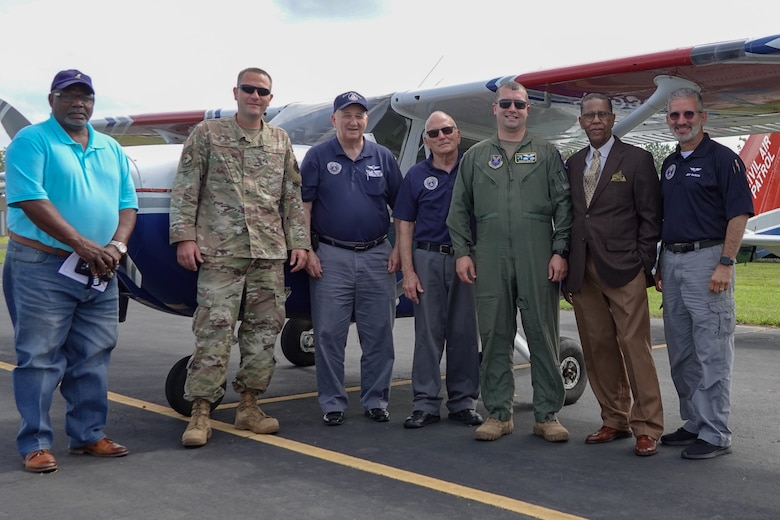 Airmen from the 2nd Bomb Wing flight safety office and members from the Shreveport Civil Air Patrol, pose for a photo at Jonesboro Airport during a Mid-Air Collision Avoidance safety training May 28, 2021. MACA is a program where members of the flight safety office travel to various airports spreading general awareness of hazards in the area, educating local aviators by answering their questions and avoiding mid-air collisions through preparedness. (Courtesy photo by Capt. Dustin Martin)