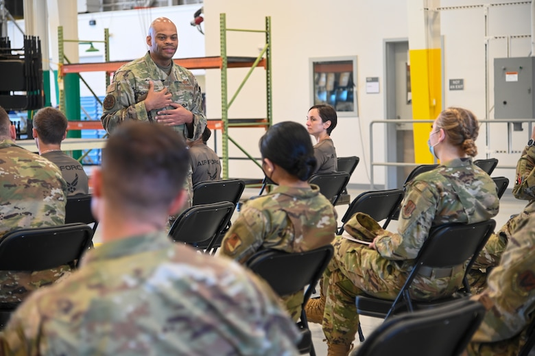 Chief Master Sgt. Travon W. Dennis, command first sergeant, Air Force Reserve Command, Robins Air Force Base, Georgia, speaks with Airmen at an E-4 and Below meeting June 13, 2021, at Beale AFB, California.