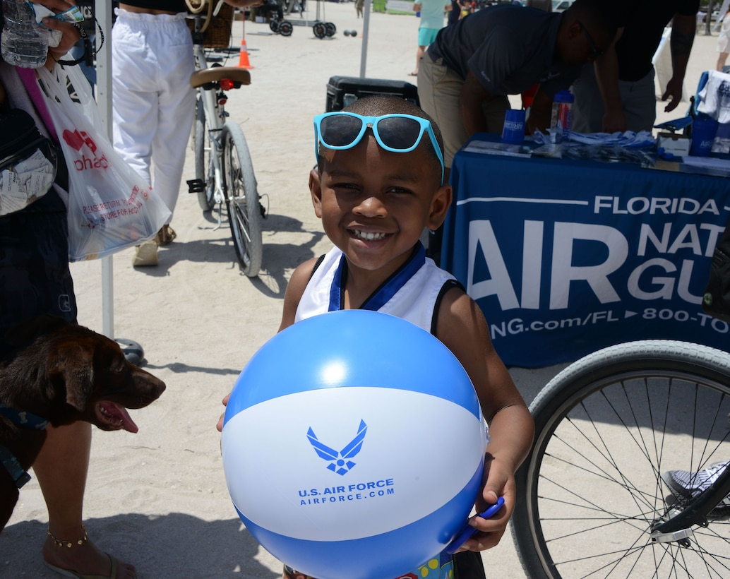 A young aviation enthusiast shows off his Air Force beachball while visiting the Total Force recruiting team at the Miami Beach Air Show, May 28, 2021.