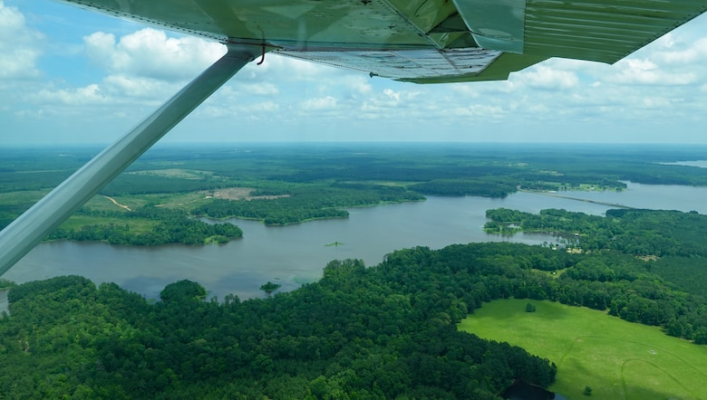 A Civil Air Patrol Cessna 182 Skylane, flies over Lake Bistineau, Louisiana, during a Mid-Air Collision Avoidance safety flight May 28, 2021. MACA visits are conducted at various airports within a 50 nautical mile radius of Barksdale in which the CAP is tasked to move military personnel to help support Air Force mission safety requirements in different locations. (Courtesy photo by Master Sgt. Steven Vance Jr.)