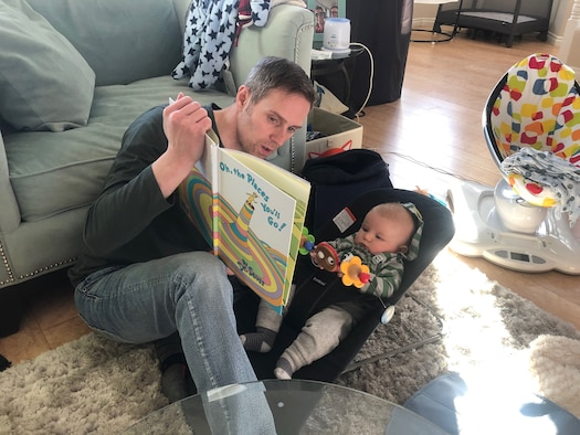 Nick Barnes reads to his son.