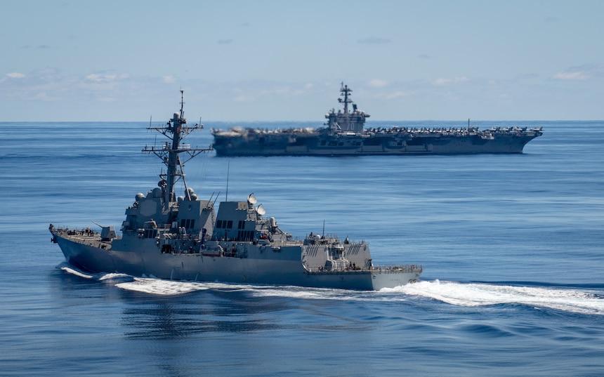 Arleigh Burke-class guided-missile destroyer USS Dewey (DDG 105), front, and Nimitz-class aircraft carrier USS Carl Vinson (CVN 70) transit the Pacific Ocean June 13,
