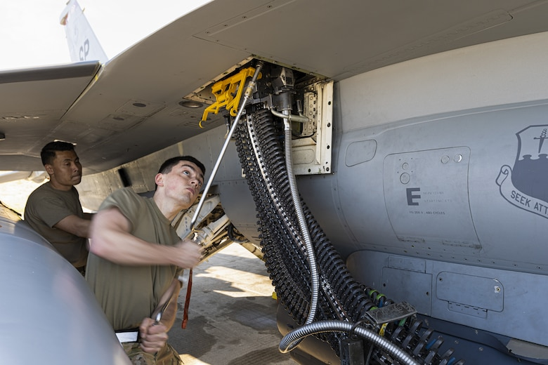 U.S. Air Force Airmen from the 52nd Maintenance Group at Spangdahlem Air Base, Germany, load ammunition into a U.S. Air Force F-16 at Kallax Air Base, Sweden, June 8, 2021. During the Arctic Challenge Exercise 21, 52nd MXS Airmen prepped the aircraft for over 450 sorties flown. (U.S. Air Force photo by Senior Airman Ali Stewart)