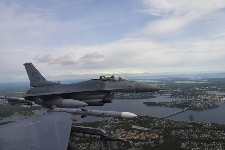 Two U.S. Air Force F-16 fly in formation over Luleå, Sweden, June 14, 2021. Exercises like the Arctic Challenge Exercise 2021 give USAF participants the opportunity to build partnerships, train with Nordic Allies, and maximize interoperability within the Nordic region. (U.S. Air Force photo by Senior Airman Ali Stewart)
