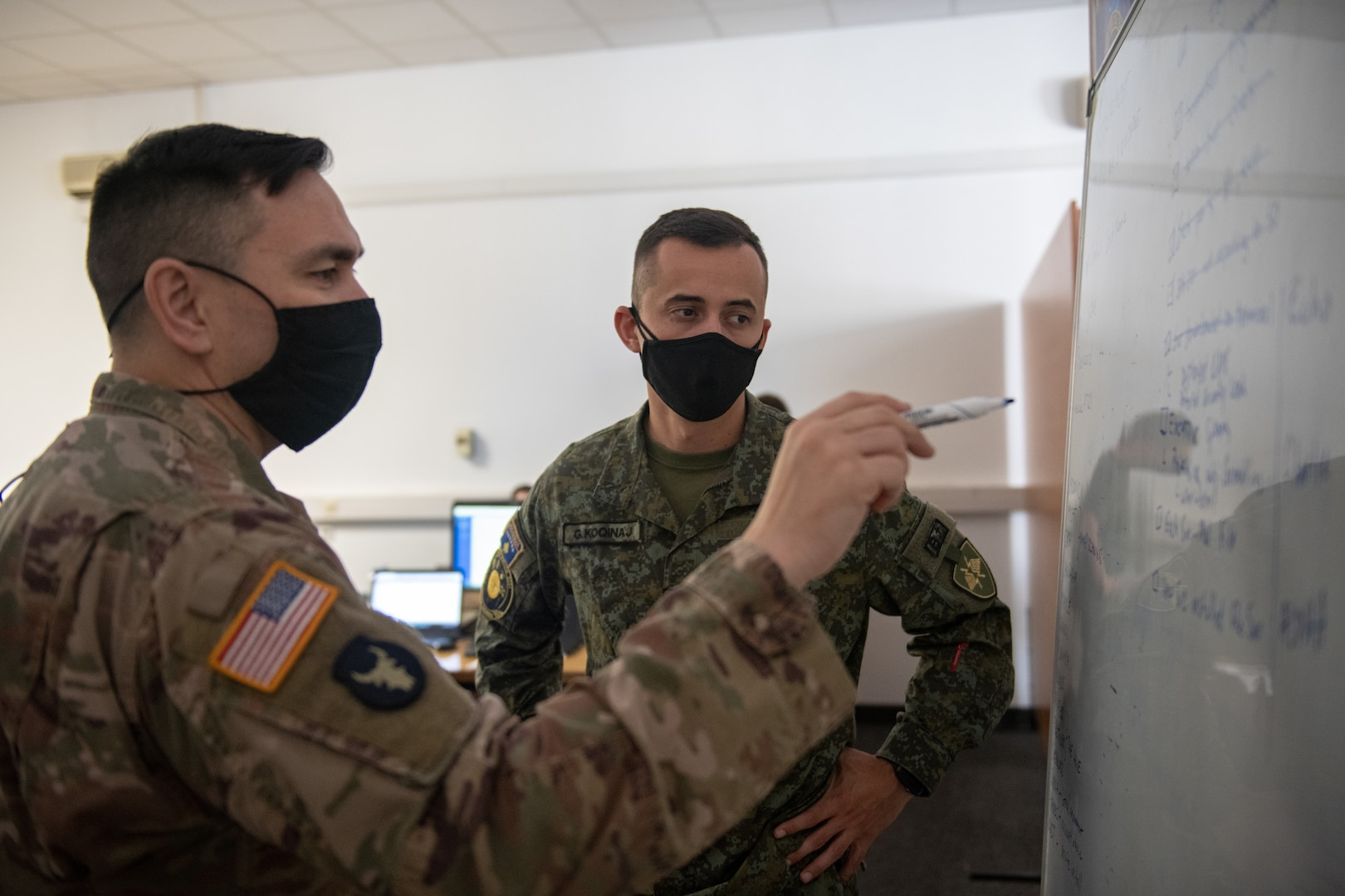 U.S. Army Lt. Col. Gene Harrigan, the defensive cyber operations team chief of the information with Minnesota National Guard Joint Force Headquarters Defensive Cyber Operations Element, explains information to Capt. Genti Koqinaj of the Kosovo Security Forces during a joint cyber training exercise, Midwest Croatia Kosovo Exercise Adriatic Thunder at Dr. Franjo Tudman Croatian Military Academy, Zagreb, Croatia, on June 15, 2021.