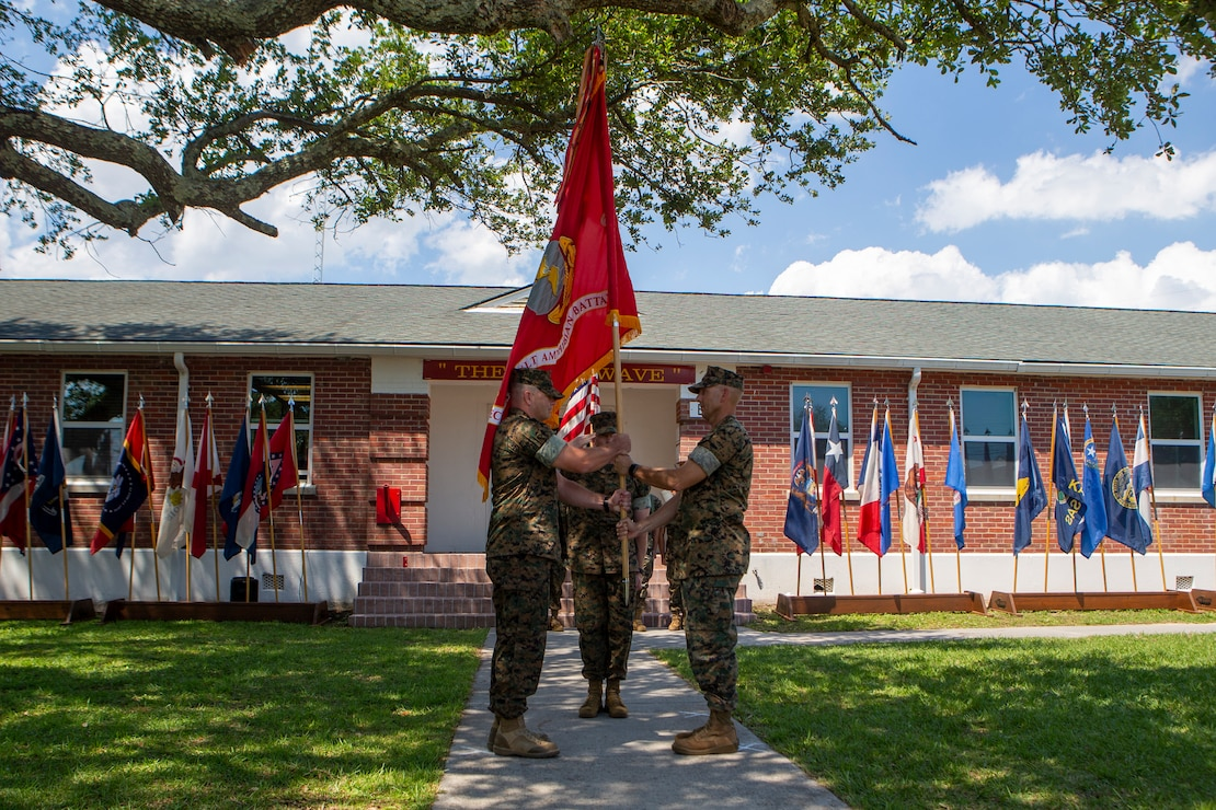 U.S. Marine Corps Lt. Col. Lynn W. Berendsen, right, the outgoing commanding officer of 2d Assault Amphibian Battalion, 2d Marine Division, relinquishes command to Lt. Col. John Kennedy, the incoming commanding officer, during a change of command ceremony on Camp Lejeune, N.C., June 17, 2021. The ceremony between commanding officers represents the transfer of authority, responsibility, and accountability. (U.S. Marine Corps photo by Pfc. Sarah Pysher)