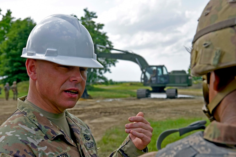 U.S. Army Col. Jon Brierton, Army Support Activity Dix, commander, discusses construction techniques with another solider during the Castle Installation Related Construction exercise on Joint Base McGuire-Dix-Lakehurst, N.J., June 14, 2021. The 668 Engineer Vertical Construction Company out of New Windsor, N.Y., conducted their Reserve Annual Training by overhauling the vehicle training site in preparation for the brand new incoming Joint Light Tactical Vehicles.