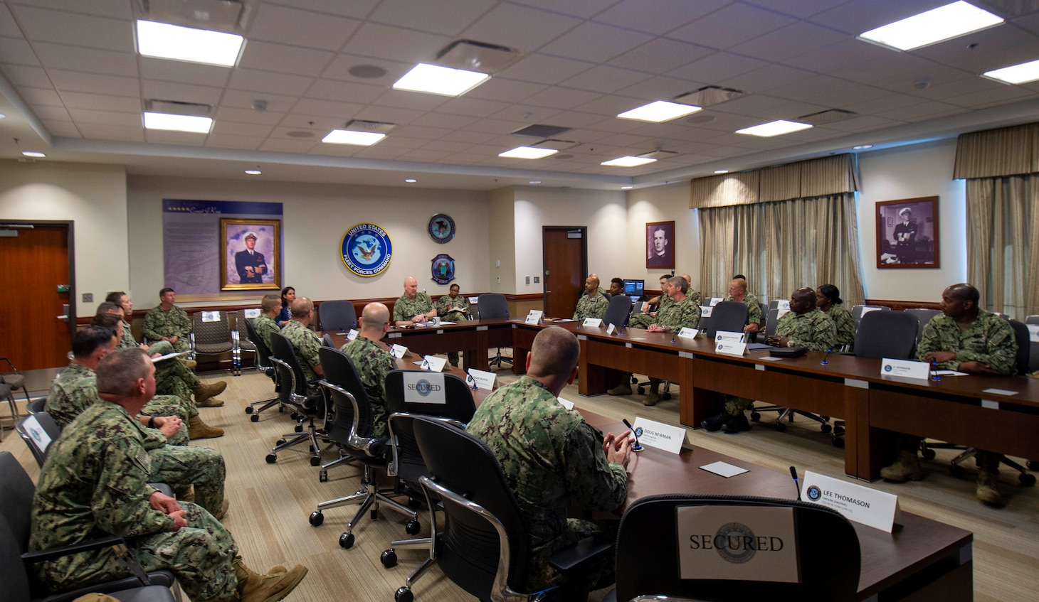 Adm. Christopher W. Grady, commander, U.S. Fleet Forces Command (USFFC), center, speaks with 17 command master chief petty officers during a Senior Enlisted Executive Leadership Symposium held at USFFC, June 15 - 17, 2021.