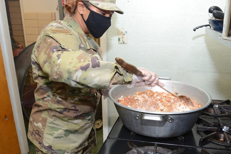 U.S. Air Force Master Sgt. Denise Bhola, a food services specialist assigned to the 169th Fighter Wing, McEntire Joint National Guard Base, South Carolina, supports Operation Healthy Delta, a Department of Defense sponsored Innovative Readiness Training program designed to provide military training opportunities by providing key services to local citizens. Bhola is cooking food for the military personnel working at  Caruthersville, Missouri June 15, 2021. (U.S. Air National Guard photo by Lt. Col. Jim St.Clair, 169th Fighter Wing Public Affairs)