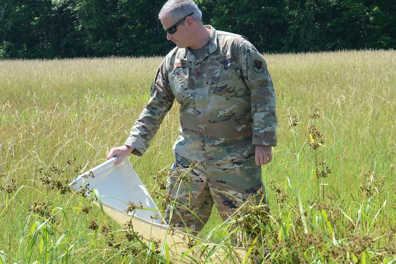 U.S. Air Force Maj. Mike Klingshirn, assigned to the 169th Fighter Wing, McEntire Joint National Guard Base, South Carolina, supports Operation Healthy Delta, a Department of Defense sponsored Innovative Readiness Training program designed to provide military training opportunities by providing key services to local citizens. Klingshirn is conducting a tick drag for vector control at Massac County High School, Metropolis, Illinois June 16, 2021. (U.S. Air National Guard photo by Lt. Col. Jim St.Clair, 169th Fighter Wing Public Affairs)