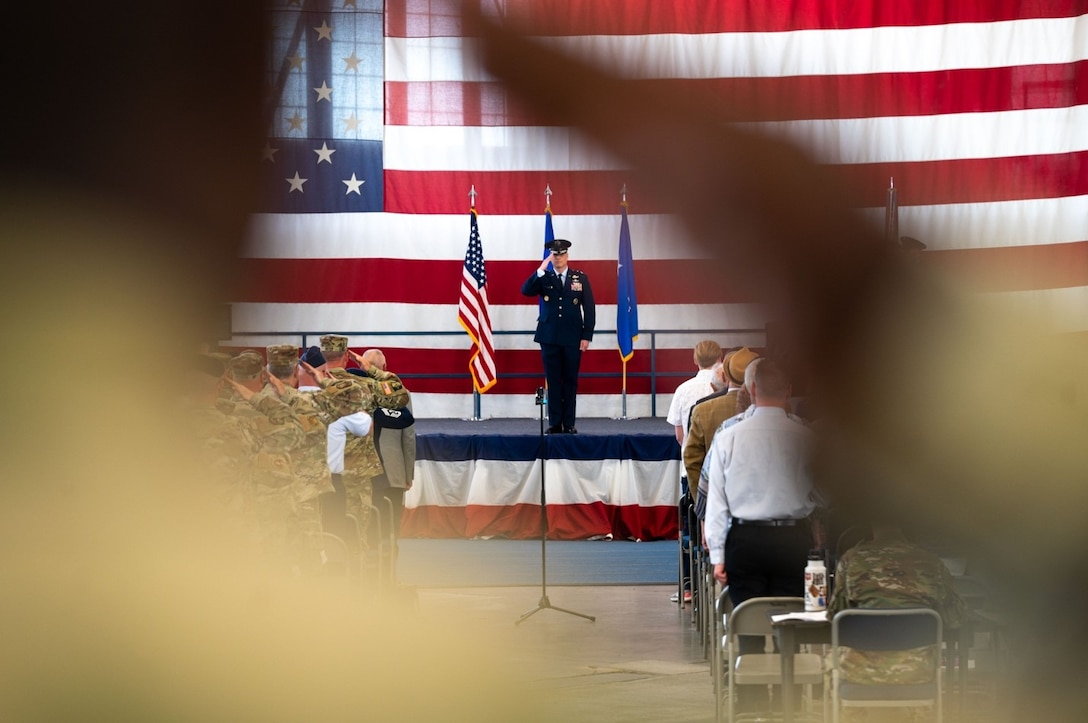 Maj. Gen. Mark E. Weatherington, 8th Air Force and Joint-Global Strike Operations Center commander, renders a salute during the playing of Ruffles and Flourishes at the 28th Bomb Wing change of command ceremony at Ellsworth Air Force Base, S.D., June 18, 2021.