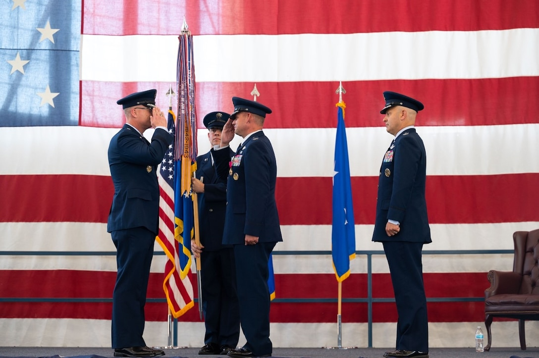 Maj. Gen. Mark E. Weatherington, 8th Air Force and Joint-Global Strike Operations Center commander, returns a salute from Col. David A. Doss, the outgoing 28th Bomb Wing commander, during the 28th BW change of command ceremony at Ellsworth Air Force Base, S.D., June 18, 2021.