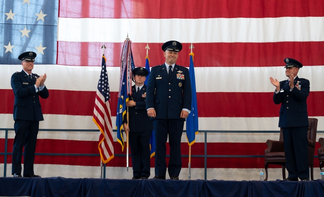 Col. Joseph L. Sheffield receives a round of applause during the 28th Bomb Wing change of command ceremony at Ellsworth Air Force Base, S.D., June 18, 2021