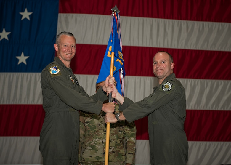 Air Force colonel passes unit guidon to another Air Force colonel