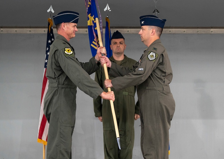 Air Force colonel passes unit guidon to Air Force general