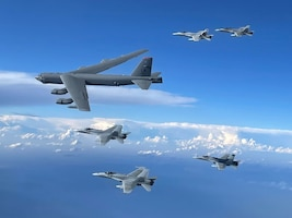 A U.S. Air Force B-52H Stratofortress operating out of Morón Air Base, Spain, flies in formation with Spanish air force F-18 aircraft in support of a Bomber Task Force Europe mission, June 3, 2021.